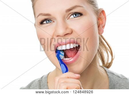 Oral hygiene and prevention. Portrait of young Caucasian female cleaning her teeth and tongue, isolated on white.