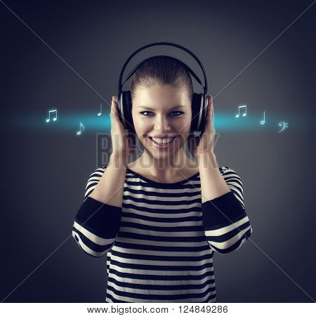 Happy female listening music in earphones with musical sketch around
