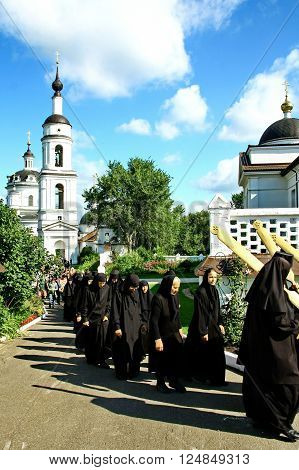 MALOYAROSLAVETS RUSSIA - AUGUST 19 2012: Nuns take part in the religious procession in Monastery of St. Nicholas in the ancient Russian city Maloyaroslavets.