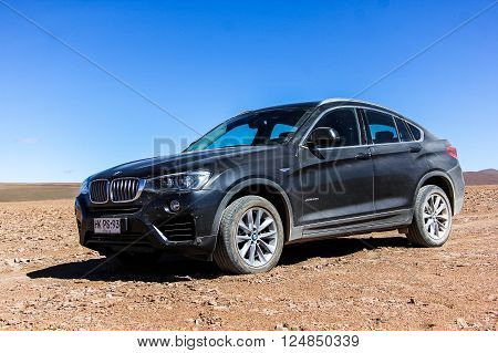 ANTOFAGASTA, CHILE - NOVEMBER 16, 2015: New black crossover BMW F26 X4 in the Atacama desert.