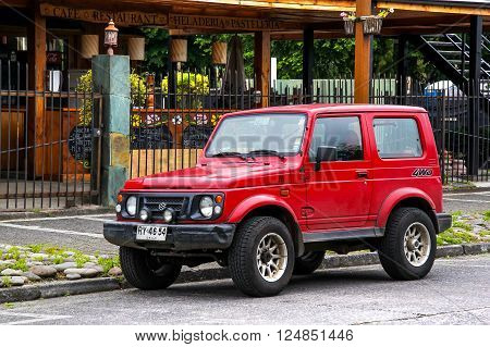 PUCON, CHILE - NOVEMBER 20, 2015: Motor car Suzuki Samurai in the city street.