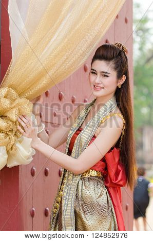 Thai woman dressing traditional. Wearing on important Day New Year's Day/ Culture traditional Day