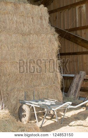 Bale of straw in the wooden farm