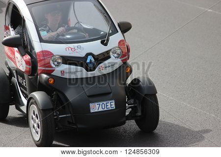 Monte-Carlo Monaco - April 6 2016: Electric Car Renault Twizy on Avenue d'Ostende in Monaco. Woman Driving an Electric Car Sharing Vehicles (Mobee) in the south of France