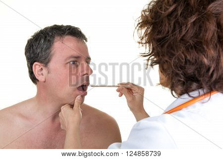 Doctor Auscultating The Throat Of A Patient In An Examination Room