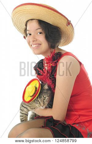 A pretty young teen festively dressed for Cinco de Mayo with her sombrero-wearing kitty.  On a white background.