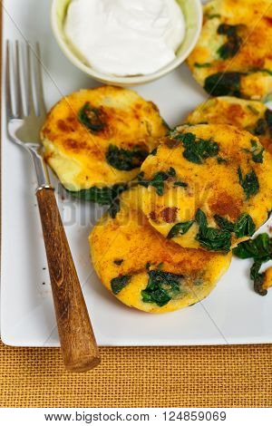 Leftover Mashed Potato Cakes With Spinach. Selective focus.