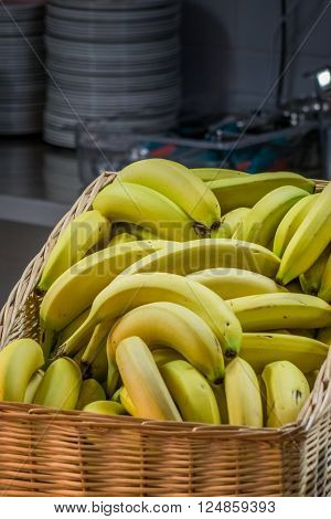 Bananas in a basket on a table in a self service breakfast counter in a hotel