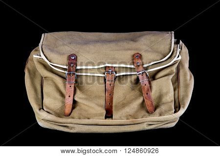 Well used canvas game and angling bag isolated on black
