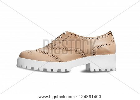 Elegant brown leather shoe on white sole isolated over white