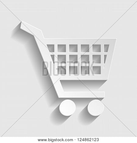 Shopping cart sign. Paper style icon with shadow on gray.
