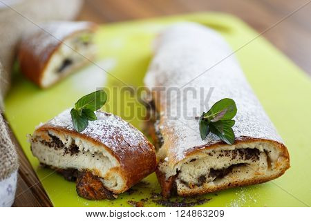 sweet roll with poppy seeds with powdered sugar