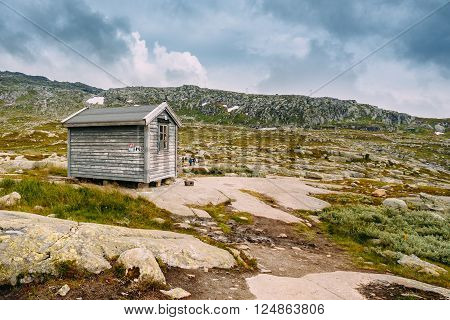 Norwegian mountains landscape. Small old wooden guest house. Travel and hiking