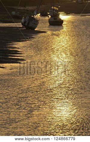 Sunrise over Wells Harbour on the North Norfolk coast, UK.