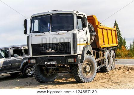 NOVYY URENGOY, RUSSIA - AUGUST 30, 2012: Off-road dump truck MAZ-6517 in the city street.