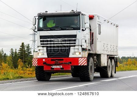 YAMAL, RUSSIA - SEPTEMBER 8, 2014: Weatherford company's gas and oil well service truck Kenworth K500 at the interurban road.