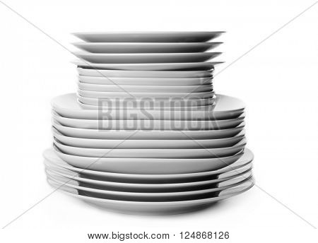 Stack of different ceramic plates, isolated on white