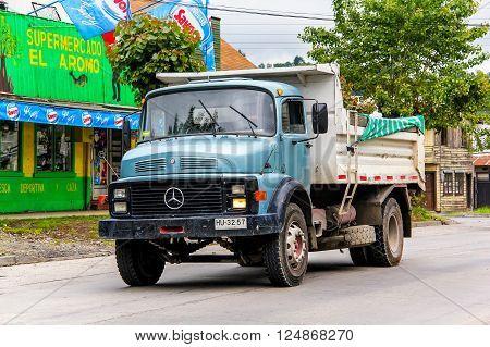 VILLARRICA, CHILE - NOVEMBER 20, 2015: Dump truck Mercedes-Benz L 1514 in the town street.