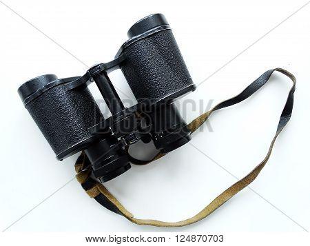 Binoculars on a table lenses zoom optics