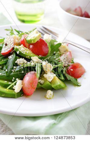 Fresh Avocado Salad With Grapes, Arugula, Blu Cheese And Sesame