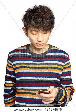 Young man using mobile phone texting on white background