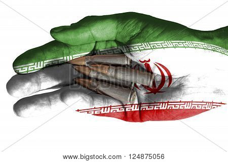 Flag of Iran overlaid the hand of an adult man holding four bullets. Conceptual image for war, violence, conflicts. Image isolated on white background