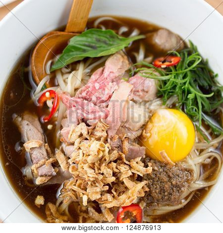 Asian beef pho noodle soup, rice noodles and vegetables. close-up. top view ** Note: Visible grain at 100%, best at smaller sizes