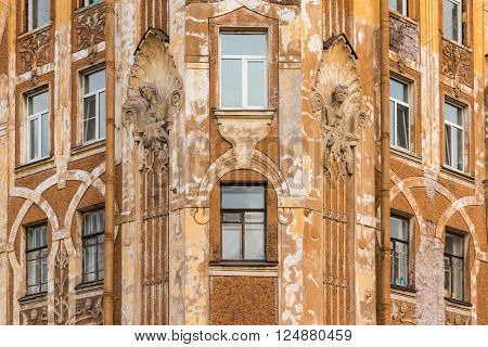 Several windows in row on corner of facade of urban apartment building front view St. Petersburg Russia