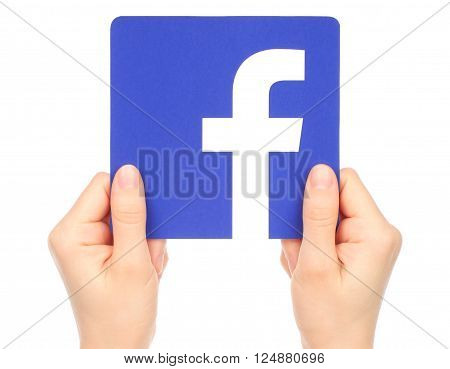 Kiev Ukraine - January 15 2016: Hands hold facebook logo printed on paper on white background. Facebook is a well-known social networking service.