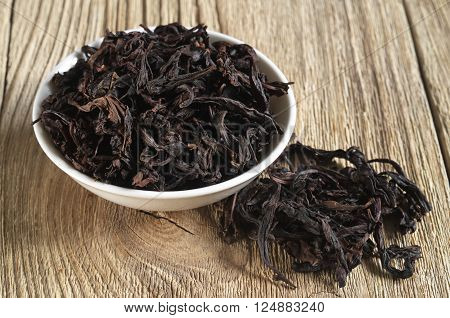 Chinese oolong tea Da Hong Pao Big Red Robe on wooden background