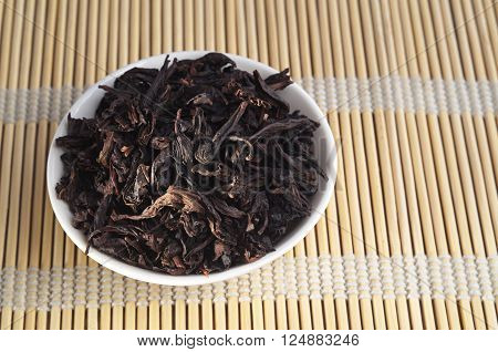 Chinese oolong tea Da Hong Pao Big Red Robe on bamboo napkin