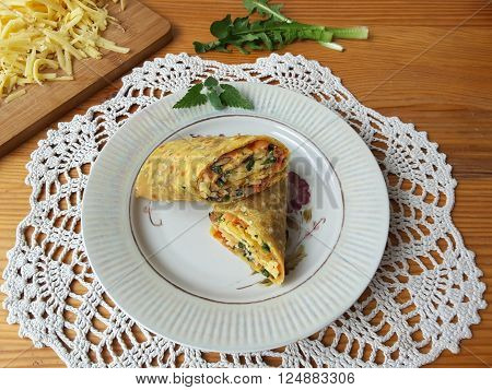 Dandelion cheese rolls on a plate, vegetarian healthy diet