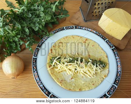 Cooking dandelion shrimp cheese rolls, food for a vegetarian diet