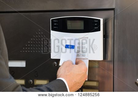 Close-up Of Businessperson Holding Keycard For Security System