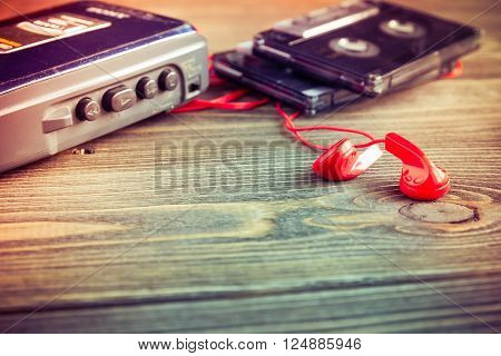 cassette tapes and player on the wood background tone in vintage style