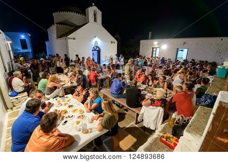 KYTHNOS, GREECE - AUGUST 14, 2014: People gathering to celebrate and feast on Assumption's eve at the church of Panagia Stratolatissa