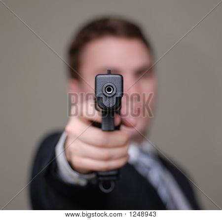 Businessman Points Gun With Shallow Depth Of Field