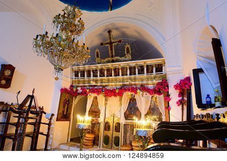 KYTHNOS, GREECE - AUGUST 14, 2014: Decorated iconostasis (templon) of the church of Panagia Stratolatissa, with needleloom embroidery and bougainvillea flowers