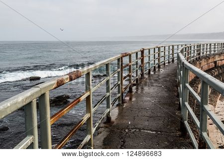 Railing and walkway to the La Jolla Children's pool, right.