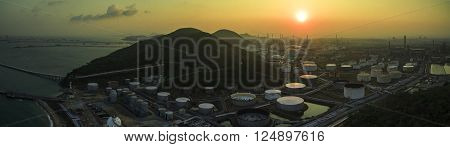 Aerial View Of Oil Refinery Tank Storage In Heavy Petrochemical Industries Estate Against Sun Rising