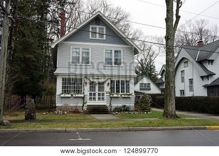 HARBOR SPRINGS, MICHIGAN / UNITED STATES - DECEMBER 23, 2015: A home labeled
