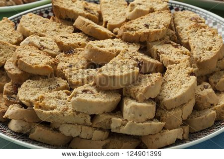 Traditional crunchy Moroccan savory spicy fekkas cookies on a dish close up