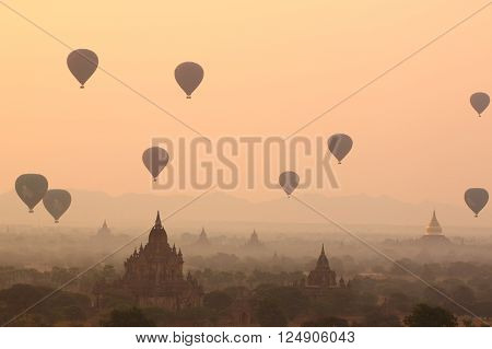 air balloons over Buddhist temples at sunrise. Bagan, Myanmar. ** Note: Soft Focus at 100%, best at smaller sizes