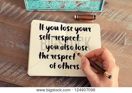 Retro effect and toned image of a woman hand writing on a notebook. Handwritten quote If you lose your self-respect, you also lose the respect of others as inspirational concept image