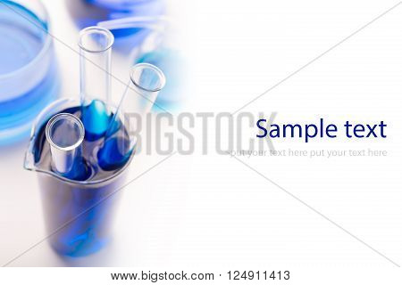 Test tubes with chemical reagent (or water) isolated on white