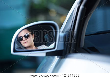 Woman Driver In Mirrow
