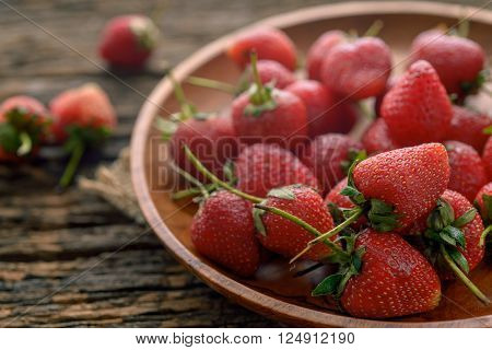Rotten Strawberries In Wooden Plate On Wooden Table