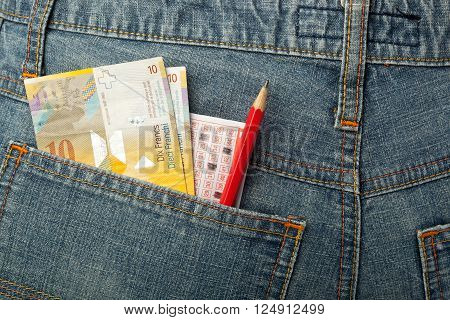 Swiss money and lottery betting slip in back pocket