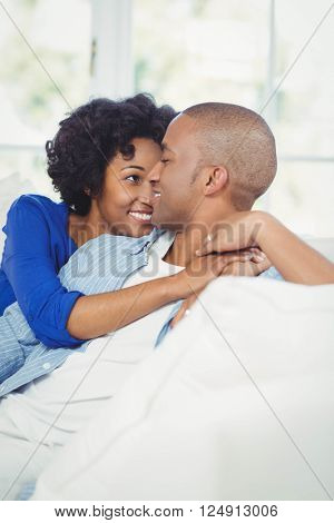 Portrait of smiling couple on the sofa looking at each other