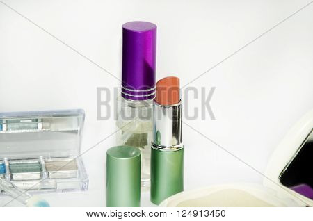 women make up simple equipment such as lipstick and powder shadow